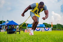 U.S. Marine Corps Staff Sgt. Reginald Berry the chief instructor for the Staff Noncommissioned Officers Academy, pulls a weighted sled in the sled pull event in Okinawa's Strongest Battle of the North, Aug. 18, 2019, Camp Hansen, Okinawa, Japan. The competition challenges men and women to compete in physically demanding events to find the strongest on the island