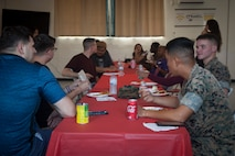 U.S. Marines and U.S. Government employees, eat dinner at the United Services Organization Volunteer Recognition at Camp Foster, Okinawa, Japan Aug. 20, 2019.