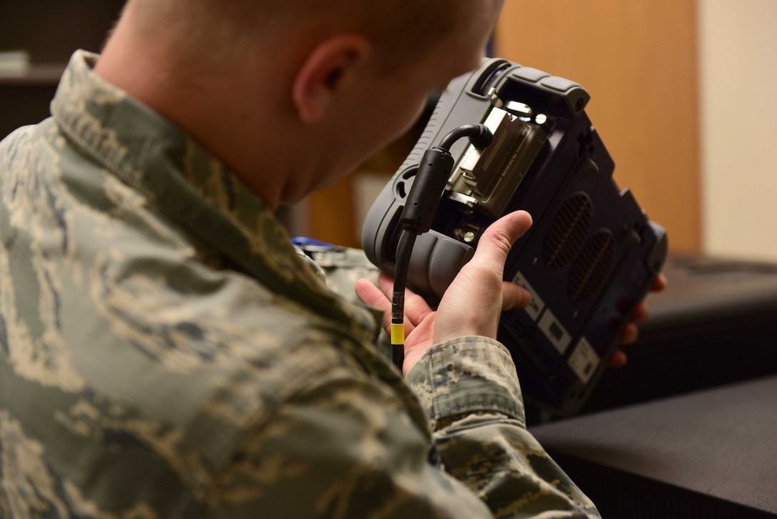 2nd Lt. Eric, 432nd Aircraft Communications Maintenance Squadron Mission Defense Team assistant officer in charge, checks communications equipment at Creech Air Force Base, Nevada, April 29, 2019. To increase the defense of the Remotely Piloted Aircraft cyber network, the Air Combat Command selected the 432nd ACMS at Creech to be the first squadron to test the possibilities of the Cyber Squadron Initiative (CS-I). (U.S. Air Force photo by Airman 1st Class Haley Stevens)