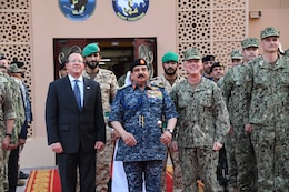 190819-N-KZ419-1051 MANAMA, Bahrain (Aug. 19, 2019) His Majesty, King Hamad bin Isa Al Khalifa, the King of the Kingdom of Bahrain, center, Vice Adm. Jim Malloy, commander of U.S. Naval Forces Central Command, U.S. 5th Fleet, right, and the U.S. Ambassador to the Kingdom of Bahrain, the honorable Justin Siberell, pose for a photo during a visit to discuss operations in the U.S. 5th Fleet area of operations. The King was accompanied by two of his sons, His Highness Maj. Gen. Shaikh Nasser bin Hamad Al-Khalifa, commander of the Bahraini Royal Guard, and His Highness Lt. Col. Shaikh Khaled bin Hamad Al Khalifa, commander of the Bahraini Royal Guard Rapid Intervention Force along with other top Bahraini military leaders. Bahrain has been a partner with the United States in regional maritime security for more than 70 years. (U.S. Navy photo by Mass Communication Specialist 3rd Class Dawson Roth/Released)