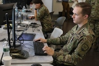 First Lt. Austin Jones, assigned to the Virginia National Guard's 91st Cyber Brigade, monitors the flow of exercise traffic through the ShadowNet platform during Cyber Yankee 19 Aug. 7, 2019, in Pembroke, New Hampshire.