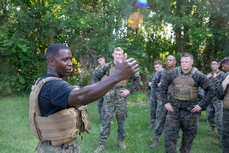 U.S. Marine Corps 1st Sgt. Marion McClary, a Martial Arts Instructor trainer with 1st Battalion, 10th Marine Regiment Battery C, 2nd Marine Division, gives students of a Martial Arts Instructor Course a brief on obstacle course safety at Camp Lejeune, N.C., Aug. 14, 2019. This three-week long course trains Marines to become Marine Corps Martial Arts Instructors. (U.S. Marine Corps photo by Cpl. Caleb T. Maher)