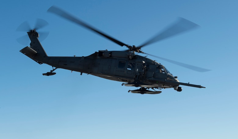 A HH-60G Pave Hawk helicopter operated by Alaska Air National Guardsmen with the 210th Rescue Squadron takes off for aerial live-fire gunnery training at Joint Base Elmendorf-Richardson, Alaska, March 19, 2019. Alaska Air National Guard HH-60G Pave Hawk helicopter special missions aviators honed their aerial gunnery skills by conducting live-fire training with the GAU-2 7.62 mm minigun. (U.S. Air Force photo by Alejandro Peña)