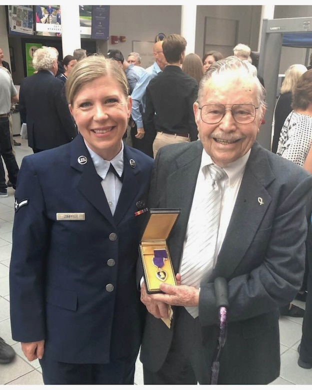 Airman Erin Zimpfer, 445th Airlift Wing Public Affairs, poses with Army veteran Albert Carr, during the Ford Oval of Honor held at the National Museum of the U.S. Air Force June 20, 2019. Mr. Carr received two Purple Hearts during his military career for his meritorious service during the second Great War.