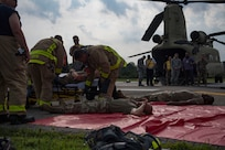 Members assigned to the 733d Civil Engineer Division treat patients during an aircraft crash exercise at Joint Base Langley-Eustis, Virginia, Aug. 13, 2019.