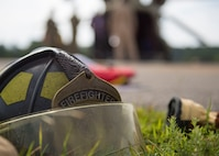 A firefighter's helmet is left at the scene during an aircraft crash exercise at Joint Base Langley-Eustis, Virginia, Aug. 13, 2019.