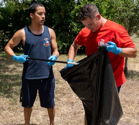 Petty Officer 2nd Class Tony Lenard (left) and Petty Officer 2nd Class Noe Lopez pick up litter at Patrolman Guadalupe Martinez Park during a community volunteer project July 30. The project was part of the Navy Sailor 360, a command-level program for junior enlisted, senior enlisted and junior officers, designed to strengthen and develop leadership through community outreach events, classroom discussions and physical training. Lenard and Lopez are assigned to the Navy Medicine Education, Training and Logistics Command at Joint Base San Antonio-Fort Sam Houston.