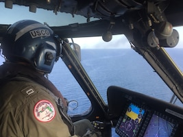 An HC-130 Hercules aircraft crew from Coast Guard Air Station Clearwater searches for two boaters August 19, 2019, off the coast of Jacksonville, Florida.