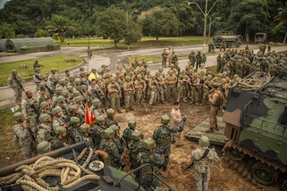 Marines gather for a safety brief.