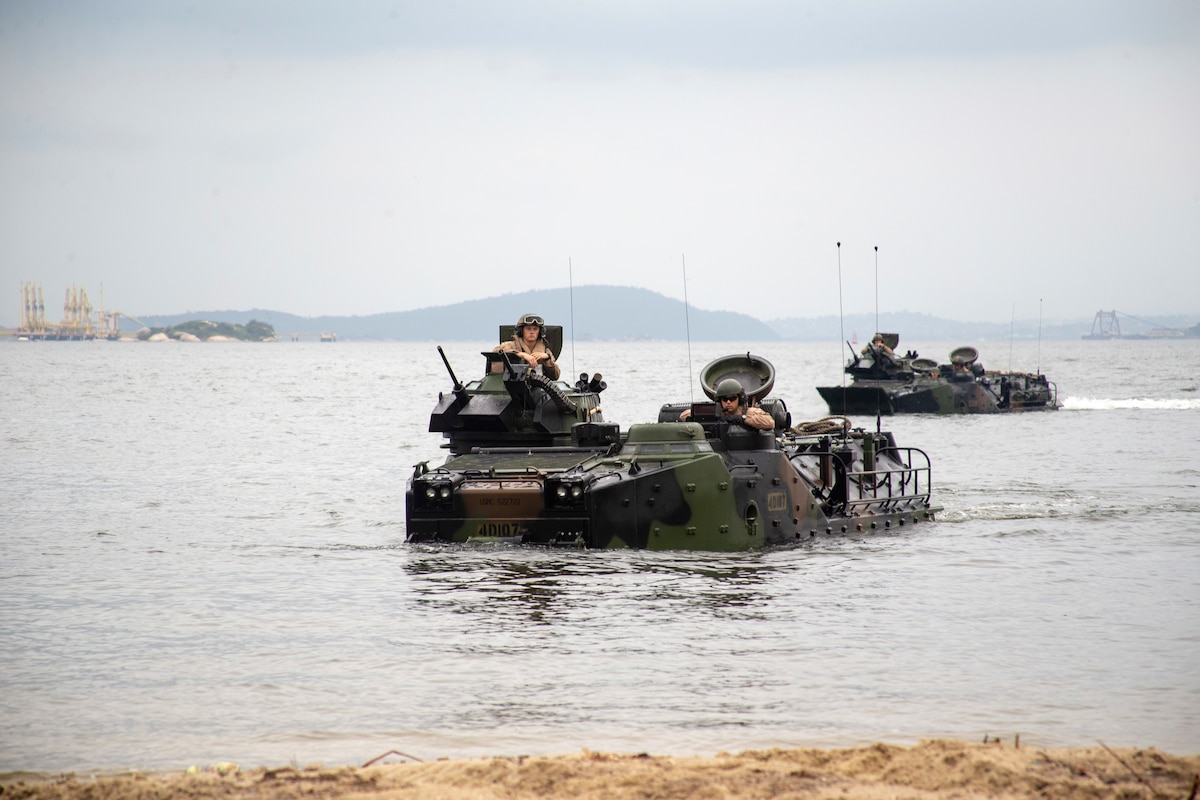 Marine amphibious assault vehicles in the water.