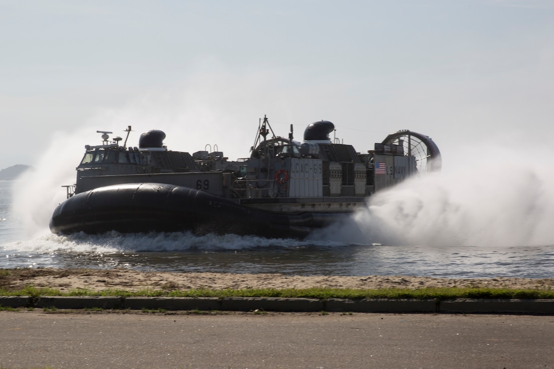 U.S. Navy landing craft, air cushion arrive with heavy equipment to be used for UNITAS LX on the Brazilian Marine Corps Base of Ilha do Governador, Brazil, Aug. 18, 2019. This equipment is used to aid in supporting humanitarian assistance and disaster relief scenarios. UNITAS is the world's longest-running, annual exercise and brings together multinational forces from 11 countries to include Brazil, Colombia, Peru, Chile, Argentina, Ecuador, Panama, Paraguay, Mexico, Great Britain and the United States. The exercise focuses on strengthening the existing regional partnerships and encourages establishing new relationships through the exchange of maritime mission-focused knowledge and expertise during multinational training operations.