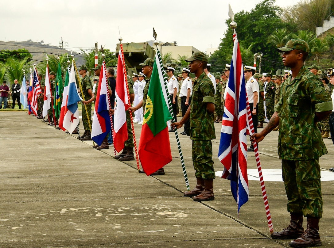 """Military members from 13 countries stand in formation at the opening ceremony of UNITAS LX in Rio de Janeiro, August 19, 2019. UNITAS, which means """"unity"""" in Latin, is a demonstration of the U.S. commitment to the region and to the value of the strong relationships forged with our partners there."""