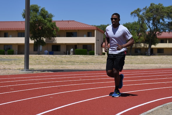 U.S. Air Force Staff Sgt. Tyrone Taylor, 373rd Training Squadron C-17 Globemaster III crew chief instructor, runs on the Fitness Center Track Aug. 19, 2019, at Travis Air Force Base, California. The tracks recently underwent renovations which included ripping the old track from the ground, placing a solid base of concrete and asphalt, laying down eight layers of rubber padding and painting stripes on the new lanes. (U.S. Air Force photo by Airman 1st Class Cameron Otte)