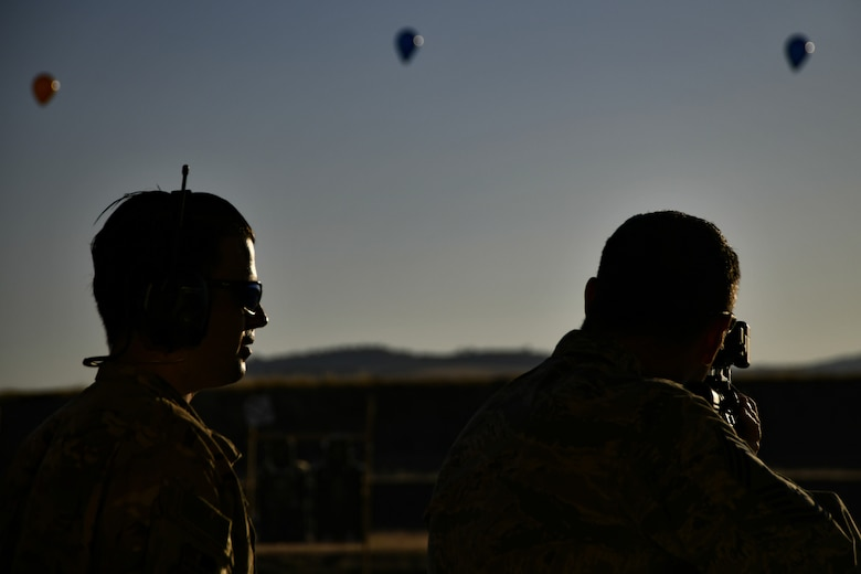 Chief Master Sgt. Dustin Hall, 9th Reconnaissance Wing command chief, receives instruction on how to use the Smart Shooter sighting device from Staff Sgt. Colton Becker, 9th Security Forces Squadron training flight, during a demonstration at Beale Air Force Base, California, Aug. 14, 2019. The 9th SFS Airmen have been using off the shelf commercial technology to help train and improve how their missions are conducted to protect the installation and the Beale AFB mission. (U.S. Air Force photo by Tech. Sgt. Alexandre Montes)