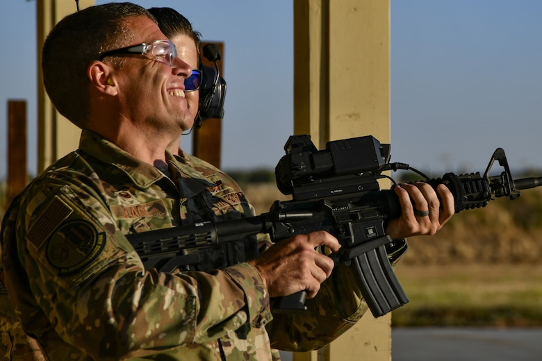 Col. Andrew Clark, 9th Reconnaissance Wing commander, tests the Smart Shooter sighting device with Staff Sgt. Colton Becker, 9th Security Forces Squadron training flight, during a demonstration at Beale Air Force Base, California, Aug. 14, 2019. The 9th SFS Airmen have been using off the shelf commercial technology to help train and improve how their missions are conducted to protect the installation. (U.S. Air Force photo by Tech. Sgt. Alexandre Montes)