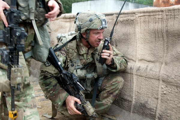 A Soldier with 1st Battalion, 124th Infantry, 53rd Infantry Brigade Combat Team, radios leadership during a three-day brigade-level field training exercise at Camp Shelby, Mississippi, Aug. 19, 2019.  The 53rd IBCT participated in eXportable Combat Training Capability program.
