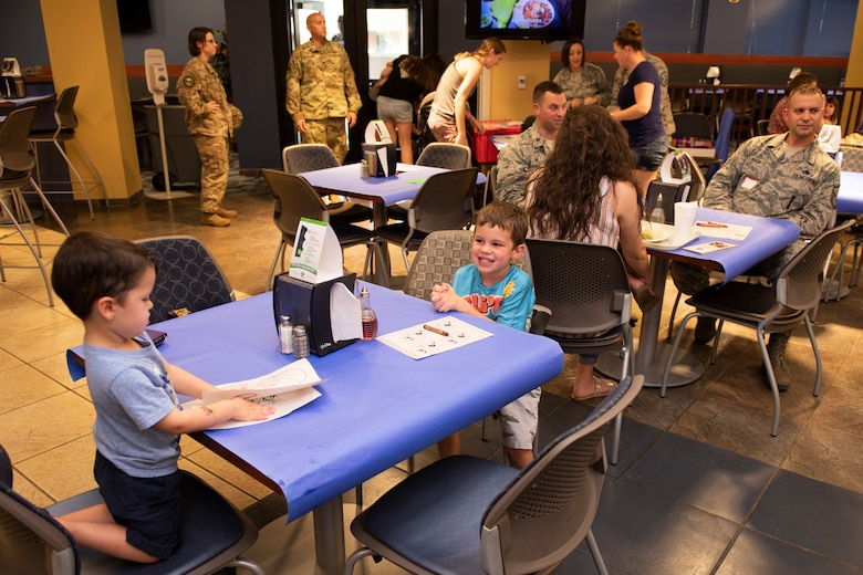 Family members of Airmen from the 23d Wing and 93d Air Ground Operations Wing participate in a Deployed Spouse's Dinner Aug. 20, 2019, at Moody Air Force Base, Ga.  The dinner served as an opportunity for the families of deployed members to bond and provide relief. The mission's success depends on resilient Airmen and families, who are prepared to make sacrifices with the support of their fellow Airmen, local communities and leadership. (U.S. Air Force photo by Airman Elijah M. Dority)