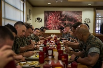 U.S. Marines with Headquarters and Headquarters Squadron (H&HS), eat breakfast and talk with the Commanding Officer and Sergeant Major of H&HS, on Marine Corps Air Station Yuma, Ariz., August 20, 2019. Having breakfast with the Commanding Officer is intended to boost squadron morale as well as give junior Marines an opportunity to familiarize themselves with their chain of command. (U.S. Marine Corps photo by Lance Cpl. John Hall)