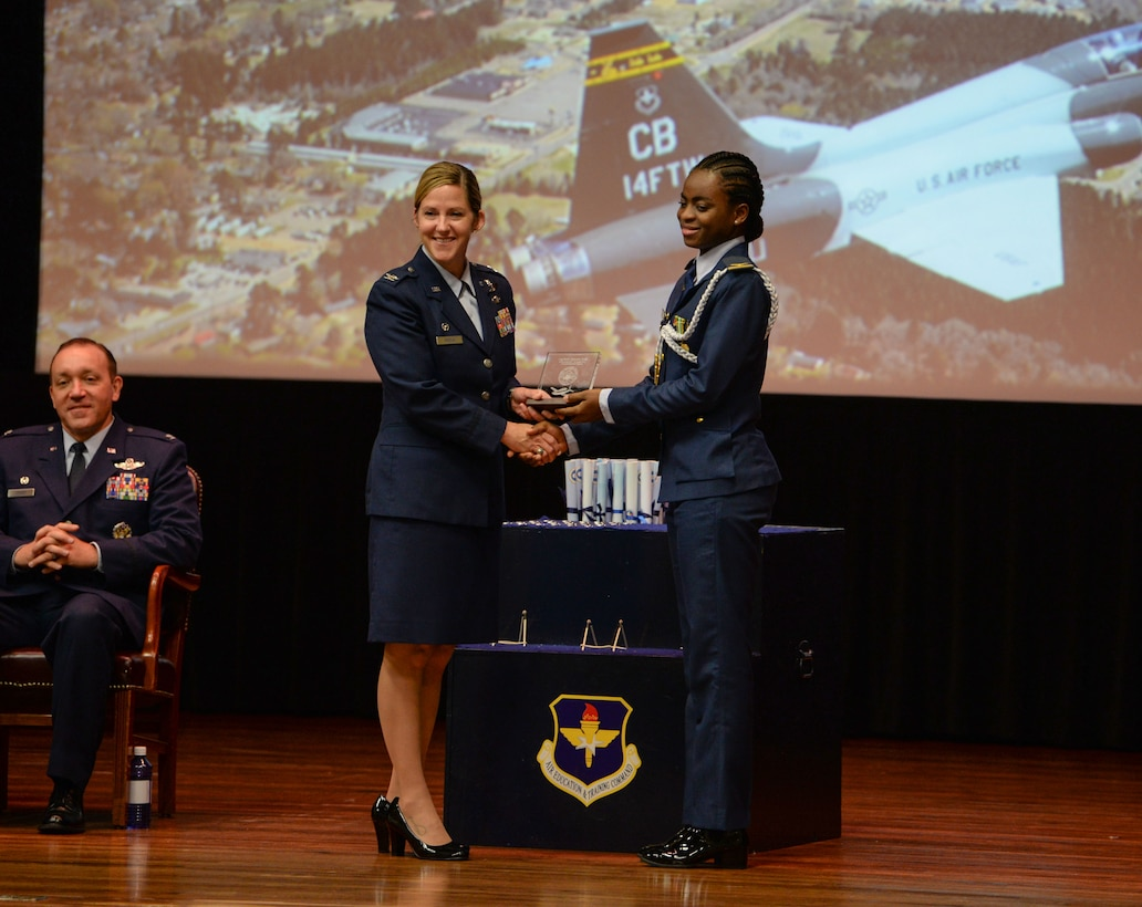 Col. Samantha Weeks, 14th Flying Training Wing commander, gives an award to 1st Lt. Sanni Kafayat, 14th Student Squadron student pilot, at the Special Undergraduate Pilot Training Class's 19-21/22 graduation ceremony Aug. 16, 2019, at Columbus Air Force Base, Miss. Kafayat is Nigeria's first female fighter pilot. (U.S. Air Force photo by Airman Davis Donaldson)