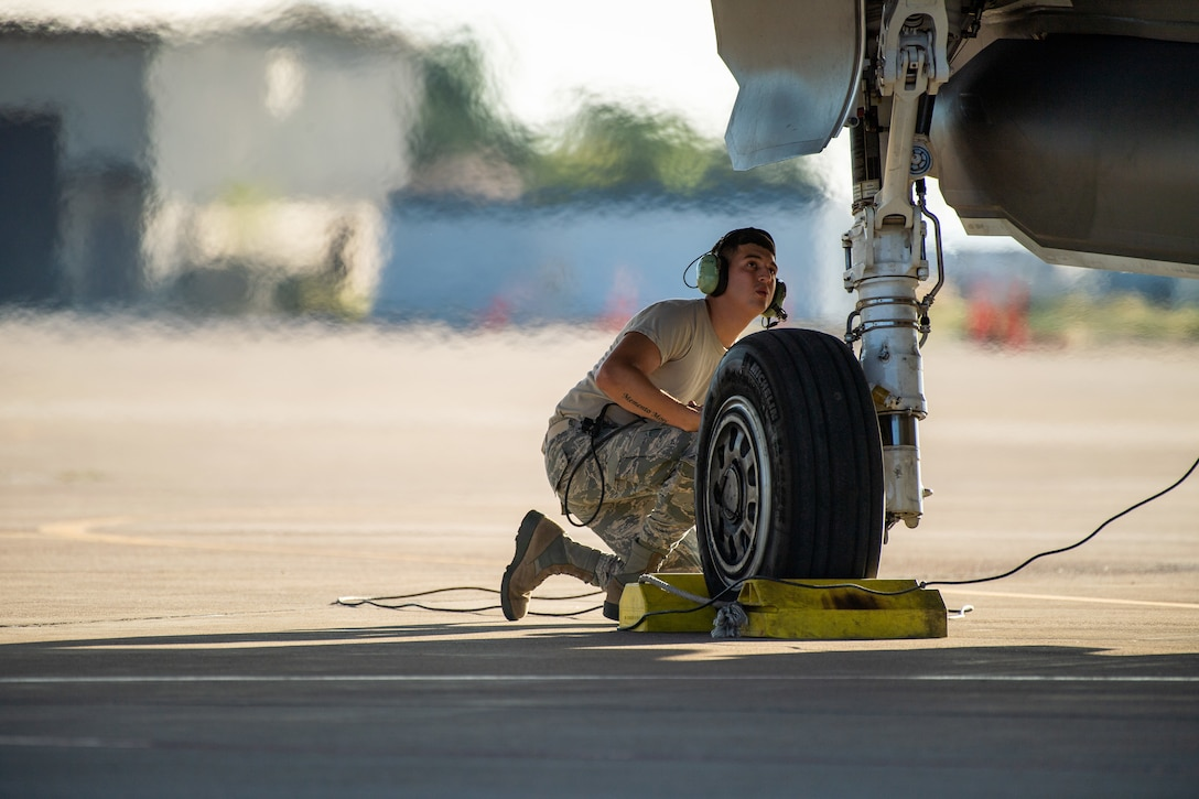 A maintainer performs pre-flight checks on an F-35A prior to take off from Hill Air Force Base, Utah, the evening of Aug. 20, 2019, as the active duty 388th and reserve 419th Fighter Wings conducted local night flying operations. The wings are required to train at night to maintain their readiness and all-weather capabilities. Increased flying also provides a valuable opportunity to evaluate aircraft maintenance resiliency and operational agility. (U.S. Air Force photo by R. Nial Bradshaw)