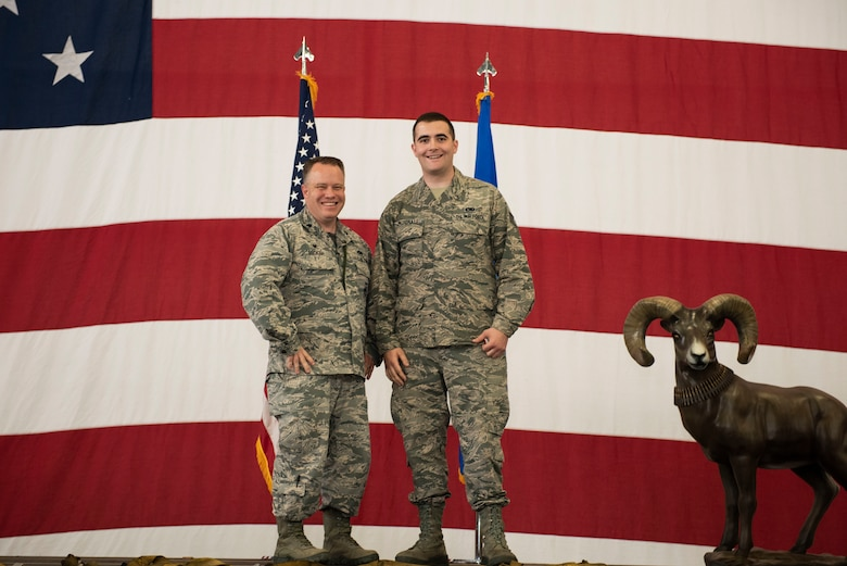 Lt. Col. Timothy Brokaw, 757th Aircraft Maintenance Squadron (AMXS) commander, and Staff Sgt. William McDonald, 757th AMXS dedicated crew chief (DCC), pose for a photo during a DCC ceremony, at Nellis Air Force Base, Nevada, Aug. 16, 2019. McDonald is one of the 34 aircraft maintainers selected for the position of DCC, who manages and supervises all maintenance performed on an assigned aircraft. (U.S. Air Force photo by Senior Airman Miranda A. Loera)