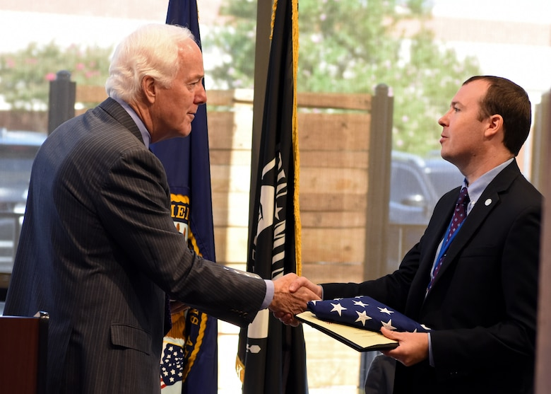 U.S. Senator John Cornyn shakes hands with West Texas Veteran Affairs Interim Director Jason Cave after presenting him a U.S. flag which was flown over The Capitol, at the San Angelo VA clinic ribbon cutting in San Angelo, Texas, August 20, 2019. Cornyn spoke on the importance of veteran healthcare and how Congress is acting on providing veterans with better services. (U.S. Air Force photo by Airman 1st Class Ethan Sherwood/Released)