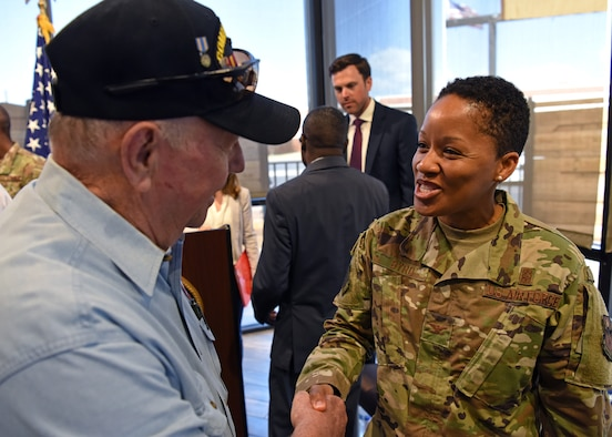 U.S. Air Force Col. Lauren Byrd, 17th Medical Group commander, shakes a veteran's hand at the Veteran Affairs clinic ribbon cutting in San Angelo, Texas, August 20, 2019. Goodfellow Air Force Base leadership attended the ribbon cutting to show their support and gratitude. (U.S. Air Force photo by Airman 1st Class Ethan Sherwood/Released)