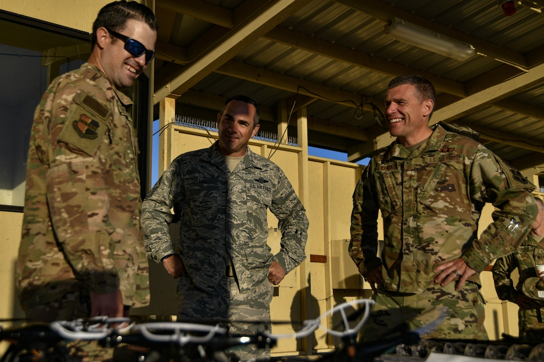 Staff Sgt. Colton Becker, 9th Security Forces Squadron training flight, gives a safety brief to Chief Master Sgt. Dustin Hall, 9th Reconnaissance Wing command chief, and Col. Andrew Clark, 9th RW commander, prior to a demonstration of the Smart Shooter sighting device at Beale Air Force Base, California, Aug. 14, 2019. The sighting device attaches to the weapon and locks on then fires to neutralize its target with or without movement. The device is also being used to limit friendly fire as the weapon cannot be fired unless it is purposely locked on. (U.S. Air Force photo by Tech. Sgt. Alexandre Montes)