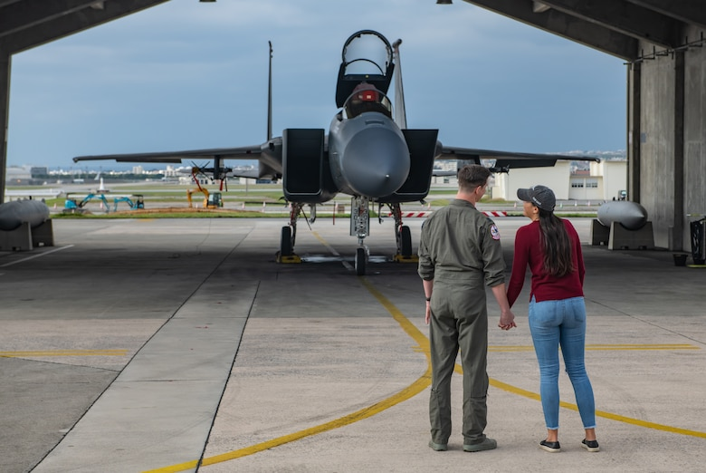 U.S. Air Force Capt. Cole Holloway a pilot from the 67th Fighter Squadron, and his wife, Meghan Holloway, take one last look at an F-15C Eagle assigned to Holloway Dec. 14, 2018, on Kadena Air Base, Japan.