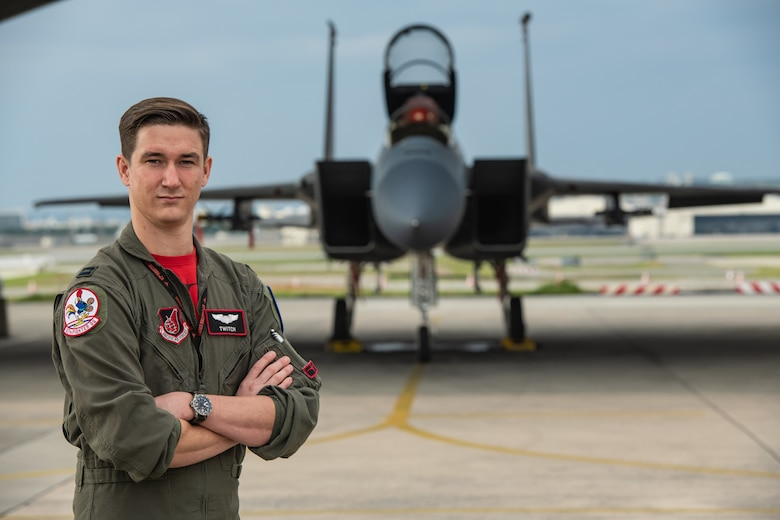 U.S. Air Force Capt. Cole Holloway a pilot from the 67th Fighter Squadron, stands in front of an F-15C Eagle Dec. 14, 2018, on Kadena Air Base, Japan.