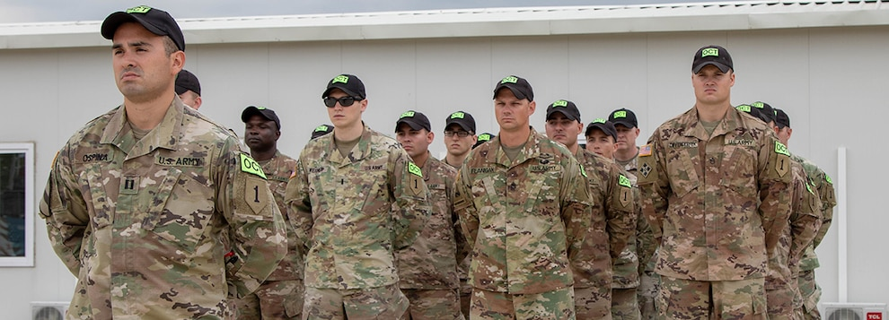 U.S. Army Soldiers, Team Raven, from 1st Armored Brigade Combat Team, 1st Infantry Division, stand in formation during the Georgia Defense Readiness Program - Training (GDRP-T) course completion ceremony at the GDRP Training Center at the Vaziania Training Area, on August 2, 2019.