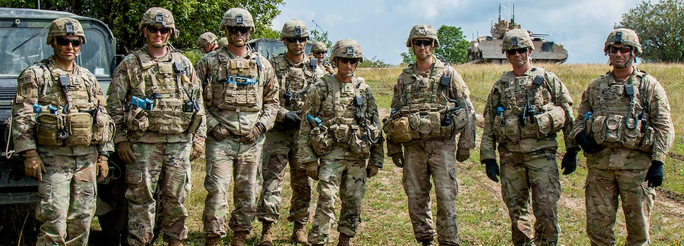 Observer Controller Trainers assigned to the Joint Multinational Readiness Center (JMRC) pose for a picture during a Combined Resolve training exercise in Grafenwoehr Training Area, August, 8, 2019.