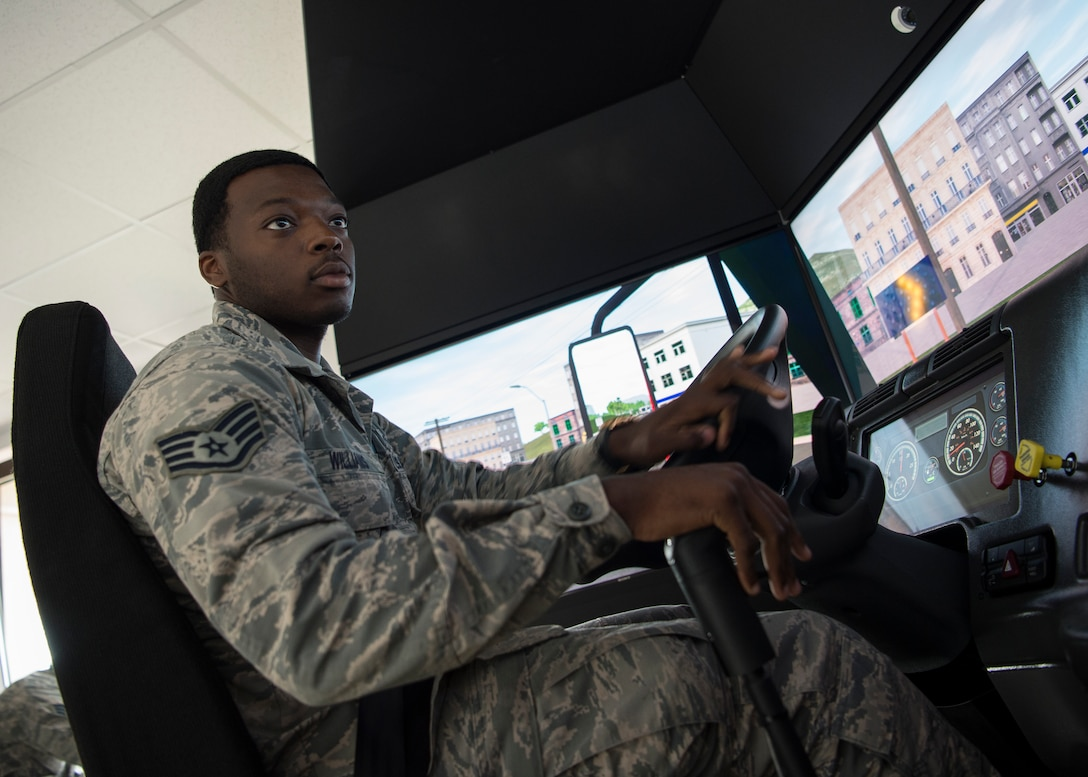 U.S. Air Force Staff Sgt. John Williams, 86th Vehicle Readiness Squadron assistant noncommissioned officer in charge of equipment support, turns on the 86th VRS's new vehicle simulator at Ramstein Air Base, Germany, Aug 7, 2019.