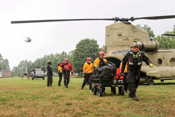 Pennsylvania National Guard members joined with partners in the Helicopter Aquatic Rescue Team (PA-HART) and other civilian first responders in a full-scale exercise at Fort Hunter Park and the Susquehanna River Aug. 15, 2019. A Ch-47 Chinook helicopter unloads a boat team at Fort Hunter Park while UH-60 Black Hawk helicopters land with members of the 28th Expeditionary Combat Aviation Brigade.