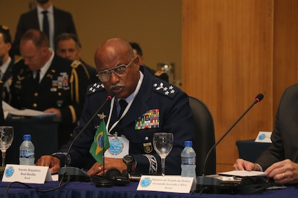 Military leaders speak at a conference.