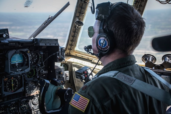 Major Ronald Barr, Pilot from the 164th Airlift Squadron, flies the C-130H Hercules April 10, 2019, at Pope Army Airfield, Fayetteville, North Carolina. Members from 164th Airlift Squadron participated in training air drops to include personnel drops with the 82nd Airborne Division. (U.S. Air National Guard Photo by Airman 1st Class Alexis Wade)