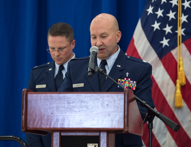 Chaplain (Lt. Col.) Daniel Pulju, 133rd Chapel Corps, gives the invocation at the 133rd Airlift Wing change of command in St. Paul, Minn., Aug. 16, 2019.