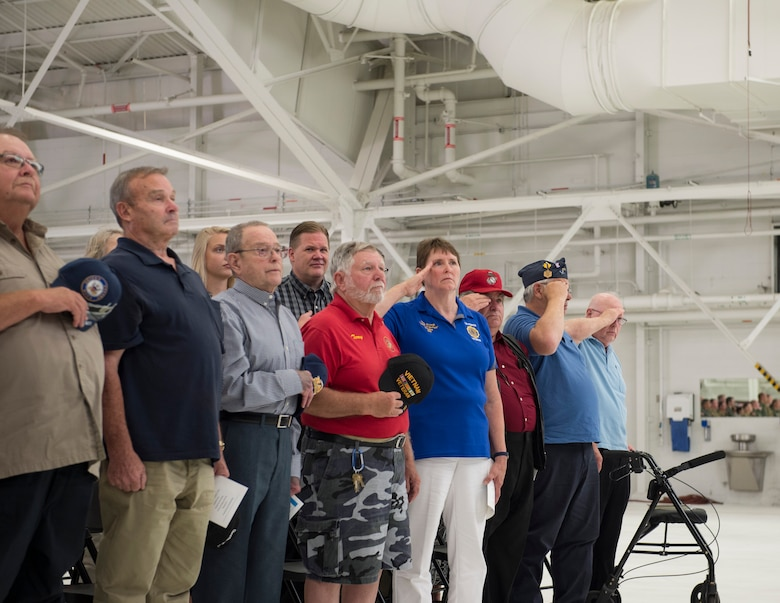 Vietnam War veterans render a hand salute at the 133rd Airlift Wing's change of command ceremony in St. Paul, Minn., Aug. 16, 2019.