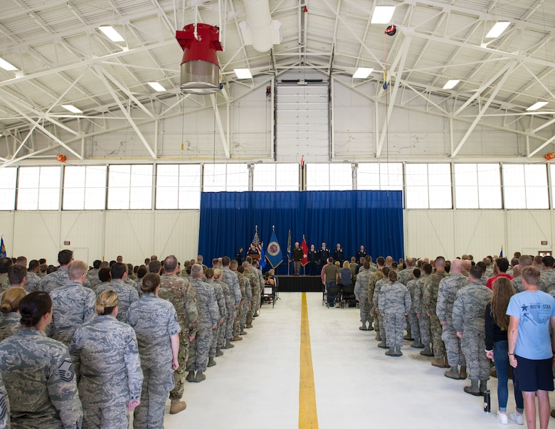 U.S. Air Force Airmen from the 133rd Airlift Wing, along with friends and family of U.S. Air Force Col's. James Cleet and Daniel Gabrielli gather for a change of command ceremony in St. Paul, Minn., Aug., 16, 2019.