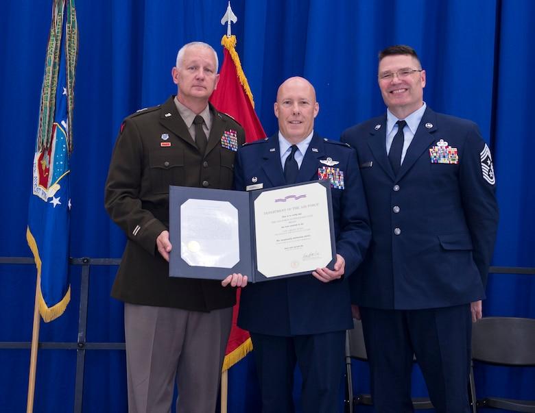 U.S. Air Force Col. Daniel Gabrielli, 133rd Airlift Wing commander, receives the Outstand Unit Award from U.S. Army Maj. Gen. Jon Jensen, Adjutant General, Minnesota National Guard, in St. Paul, Minn., Aug., 16, 2019.