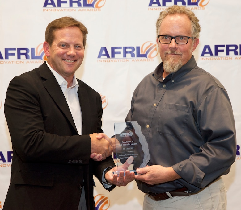 Dr. Kelly Hammett director of the AFRL Directed Energy Directorate presents David Wilt of AFRL's Space Vehicles Directorate the Excellence in Tech Transfer Award at AFRL New Mexico's 2019 Innovation Awards event held on Aug. 9 in Albuquerque, N.M.