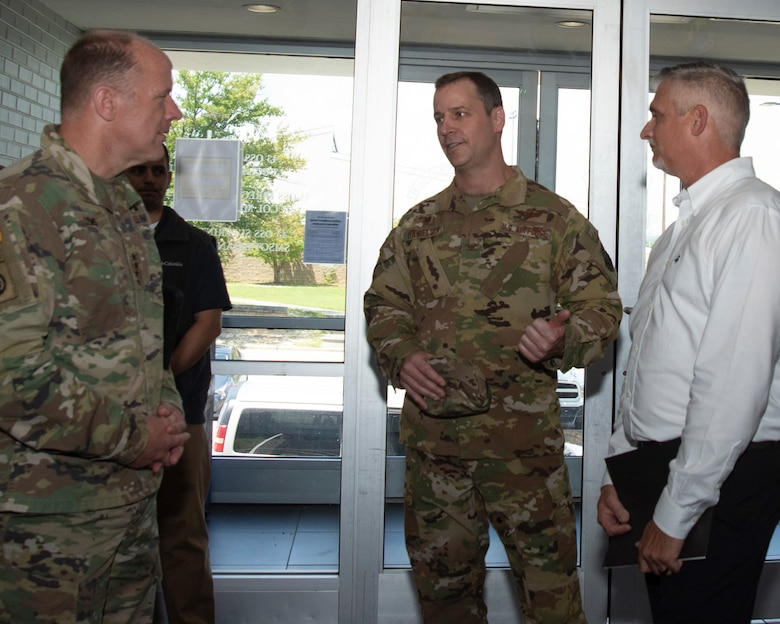 General Lyons and CMSgt France speak with 43 AMOG commander, Col Timothy Danielson during their visit to Pope AAF.