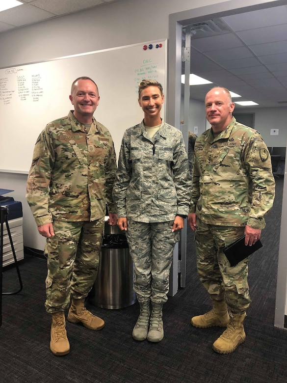 General Steven Lyons and CMSgt Jason France take time for a photo with a star performer while visiting Pope AAF.