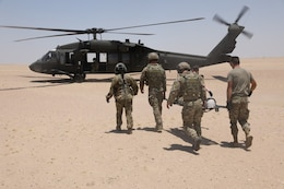 Soldiers of the 8th Assault Helicopter Battalion, 229th Aviation Regiment, also known as Task Force Javelin, conduct medical evacuation training with U.S Air Force Joint Tactical Air Controllers from the 82nd Expeditionary Air Support Operations Squadron,  July 12, 2019, at the Udairi Range Complex  near Camp Buehring, Kuwait. TF Javelin will provide medical evacuation and air assault support as part of Eager Lion 2019, U.S. Central Command's premiere exercise in the Levant region.