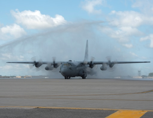 Fire engines from the Metropolitan Airport Commission give U.S. Air Force Col. Daniel Gabrielli, 133rd Airlift Wing commander, a water salute after he completes his fini-flight in St. Paul, Minn., Aug. 16, 2019.