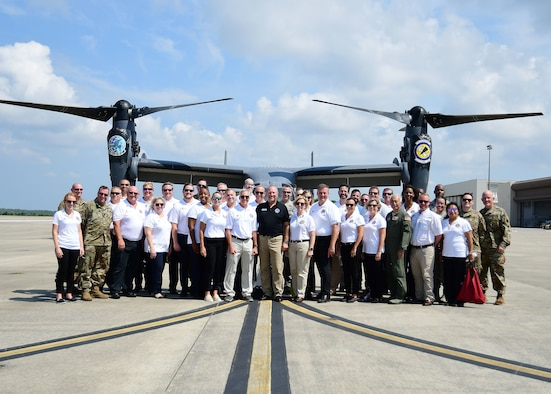 Civic leaders from metro Atlanta pose with tour coordinators in front of a CV-22 Osprey at Hurlburt Field, Florida, Aug. 14, 2019.
