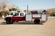 The shorter, smaller and narrower quick response fire engine in front of the larger Type-1 fire engine, is capable of accessing all areas of Marine Corps Logistics Base Barstow, California, without having to use bypass routes to get around the narrow tunnel that leads to the Marine Memorial Golf Course.