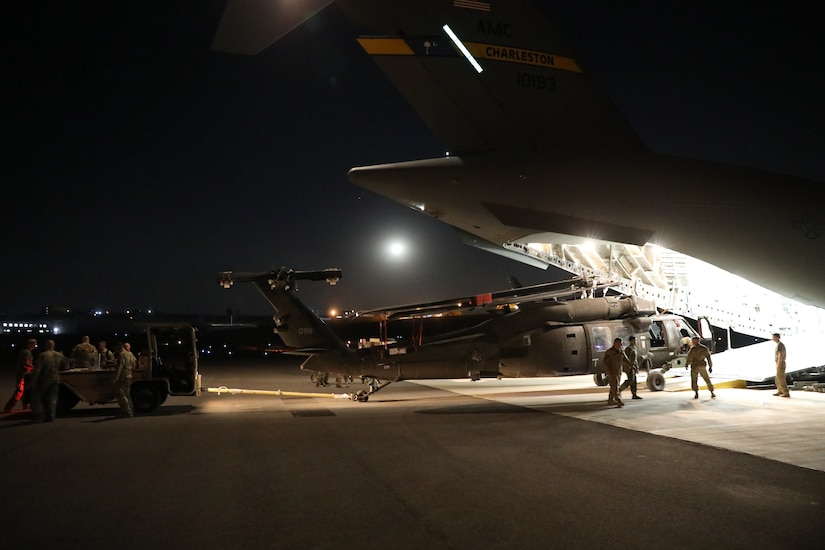 244th Combat Aviation Brigade Soldiers with Task Force Javelin offload a UH-60 Blackhawk helicopter from a U.S. Air Force Strategic Airlift C-17, shortly after arriving to King Abdullah II Air Base, Jordan, in anticipation of Eager Lion 19, Aug. 12, 2019. Eager Lion is U.S. Central Command's premiere military training exercise in the Levant region. The event provides U.S. forces, Royal Jordanian Armed Forces, and 27 other participating nations the opportunity to improve their collective ability to plan and operate in a coalition environment.
