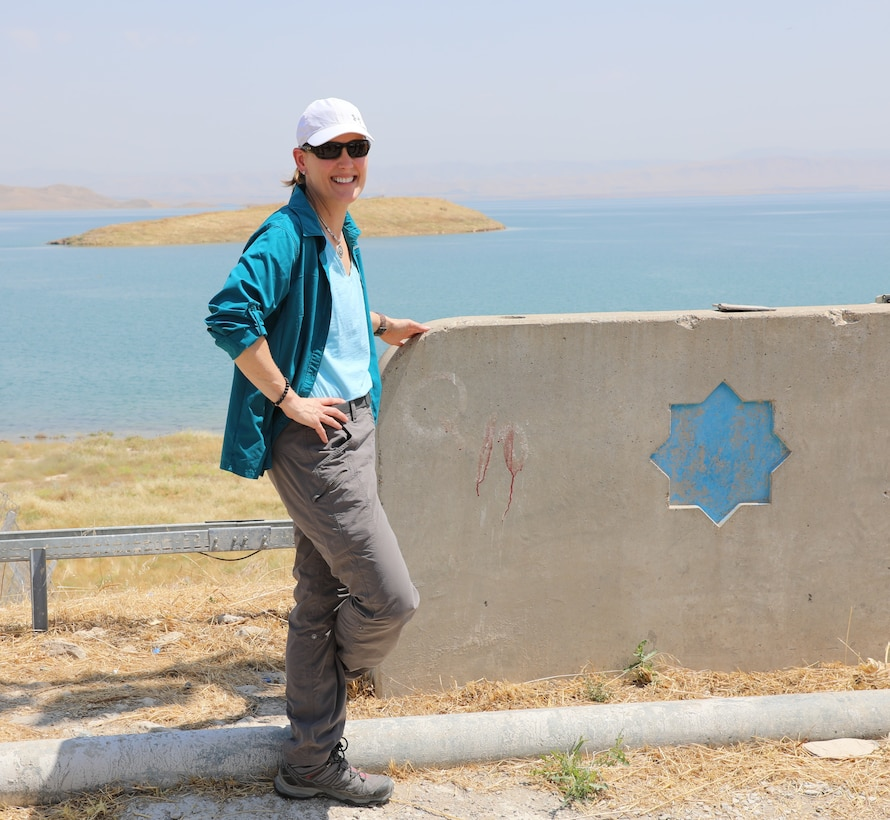 Tambour Eller on site at Mosul Dam in Iraq. Eller served as the project executive for the Mosul Dam Task Force and was recognized as the U.S. Army Corps of Engineers Employee of the Year for her work on the task force as well as work with USACE's Sacramento District and South Atlantic Division. Eller stated that her time on the task force was a wonderful experience and encouraged other USACE civilians to volunteer for deployment opportunities.