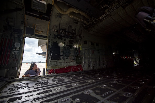 A Team Moody spouse looks inside of an HC-130J Combat King II aircraft during a Heart Link spouse orientation Aug. 21, 2019, at Moody Air Force Base, Ga. The orientation is geared toward providing all spouses and family members with the necessary support and information to ensure that they are aware of the resources available to them such as: Tricare, legal assistance, Airman and Family Readiness Center and financial assistance. During the orientation, spouses were given a static display tour to better familiarize them with the aircraft and mission here. (U.S. Air Force photo by Airman 1st Class Eugene Oliver)
